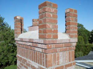 Brickwork extended to allow installation of bluestone tops