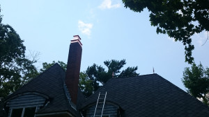 Custom copper cap installed on a very steep roof