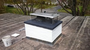 Freshly painted white, new double flue stainless steel chimney cap installed & flashseal